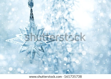 Winter blue background shiny silver star with blinking lights - stock photo