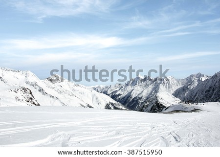 winter blue sky and slope and snow