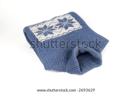 Winter blue sweater with snowflake ornament isolated over white - stock photo