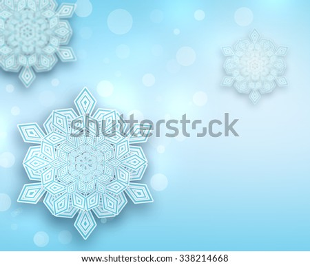 Winter bokeh background with beautiful snowflakes. Paper cut snowflake technique. Happy Holidays concept. Merry Christmas and Happy New Year theme. Light blue background with bokeh lights. - stock photo