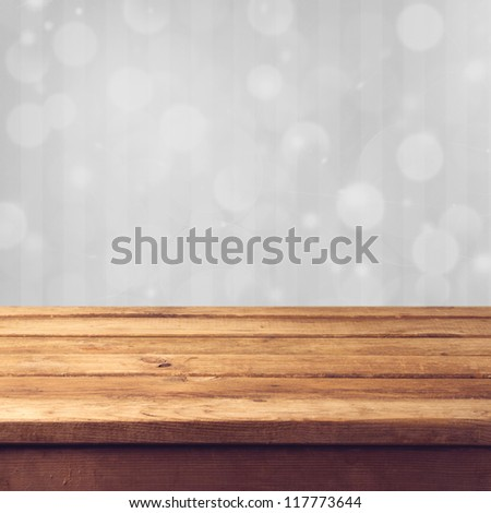 Winter bokeh background with wooden table - stock photo