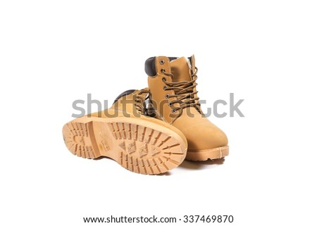 Winter boots on a white background - stock photo