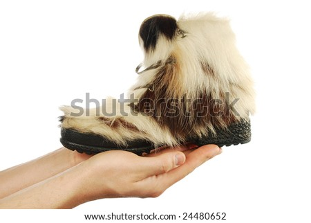 winter boots on hands on a white background