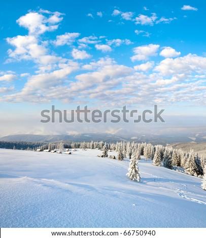 winter calm mountain landscape with sheds group and mount ridge behind (Kukol Mount, Carpathian Mountains, Ukraine) - stock photo