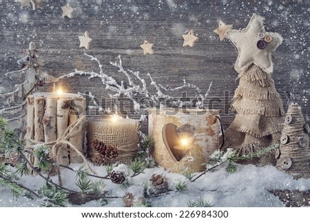 Winter candles on a wooden background - stock photo