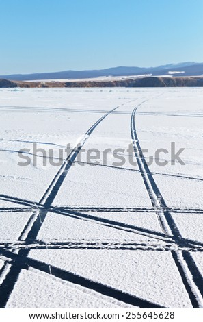 Winter car trip on the frozen Lake Baikal - stock photo
