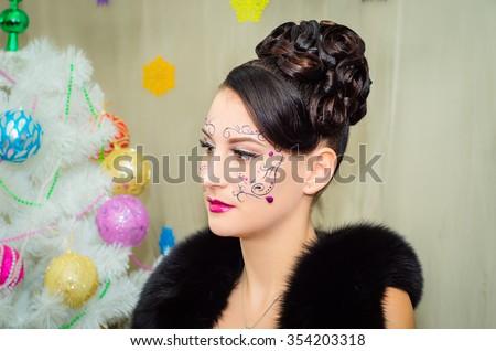 Winter Christmas eyes make up. Party art model Woman makeup. Creative Girl Holiday Make-up. - stock photo