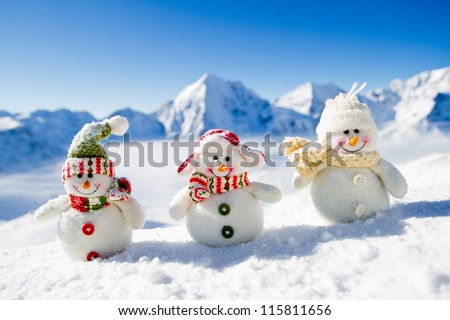 Winter, Christmas - happy snowman friends, snowy mountains in background