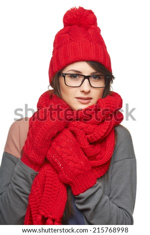 Winter, christmas, holidays concept. Smiling beautiful woman in glasses and in red hat, scarf and mittens over white background - stock photo