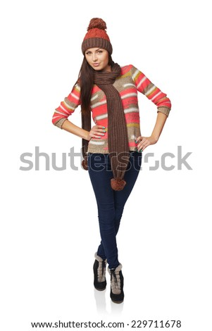 Winter, christmas, holidays concept. Smiling beautiful woman in winter clothing standing in full length over white background - stock photo