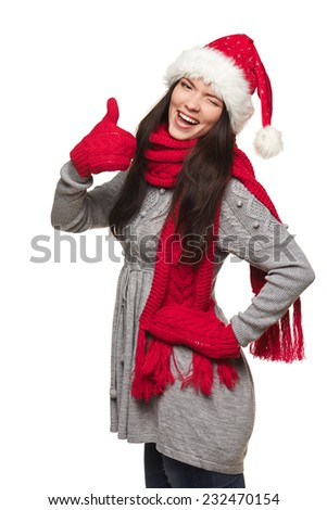 Winter, christmas, holidays success concept. Smiling beautiful woman in Santa hat winking and gesturing thumb up, over white background - stock photo