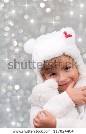Winter, Christmas,  kid - portrait of lovely girl at Christmas time, cute teddy - stock photo