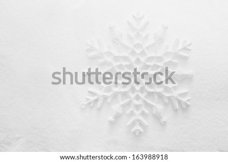 Winter, Christmas minimal elegant background. Snowflake on snow, low contrast image. - stock photo