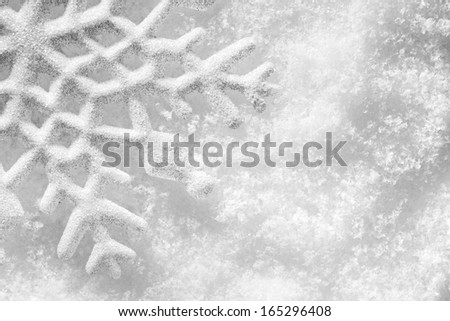 Winter, Christmas minimal elegant background. Snowflake on snow, low contrast image. - stock photo