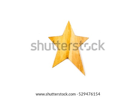 Winter, Christmas, New Year wooden decoration - yellow/brown star with ornaments, prepared from solid wood. Isolated on white background. Wooden decor - star. Top view. Closeup.