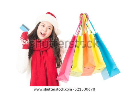 winter christmas sale shopping with credit card. happy excited holding colorful shopping bag. Mixed race Asian chinese.