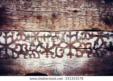 Winter Christmas Trace Pattern from Snow on a Wooden Background. Vintage - stock photo