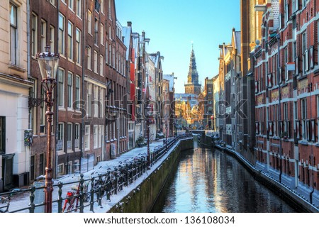 Winter cityscape of the Oudezijds kolk in Amsterdam, the Netherlands, with the Oude Kerk (old church, 1213) in the background. HDR - stock photo