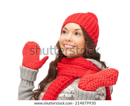 winter clothing, christmas, holidays and people concept - smiling asian woman in red hat, scarf and mittens over white background - stock photo