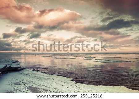 Winter coastal landscape with floating ice. Gulf of Finland, Russia. Vintage toned photo with instagram filter effect - stock photo
