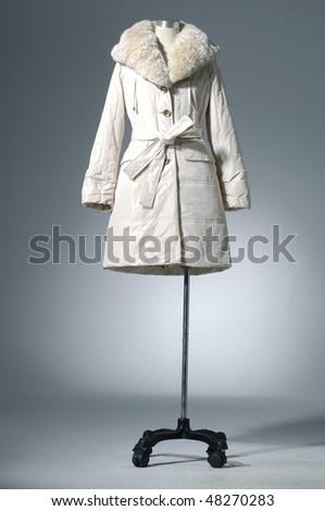 winter coat dress on mannequin - stock photo