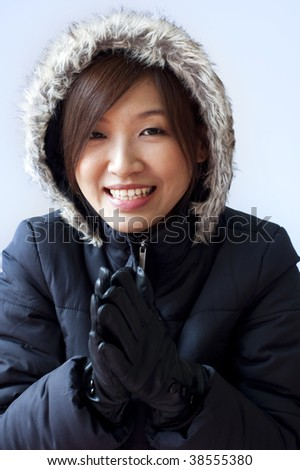 Winter coat girl with her smiling face. - stock photo