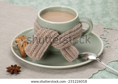 Winter Concept. Cup Of Hot Coffee, Cocoa or Tea With Milk And Spices. Old Silver Spoon. Natural Linen Table Cloth. - stock photo