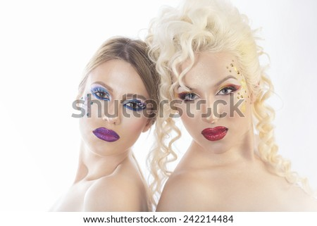 Winter concept makeup, two models - stock photo