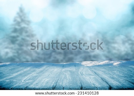 Winter concept of table in snow - stock photo
