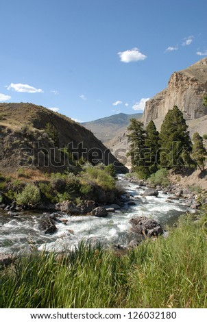 Winter Creek Runs Through Yellowstone National Park - stock photo
