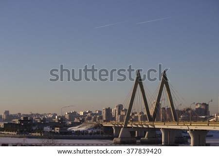winter day in city, blue sky, clouds