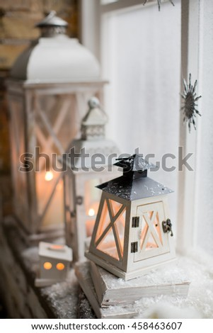 winter decor with candles and lanterns