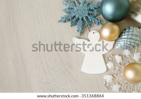 Winter decoration. Christmas composition with angel, Christmas tree toys, snowflake. Holidays background on a wooden surface. Free space for a text. - stock photo