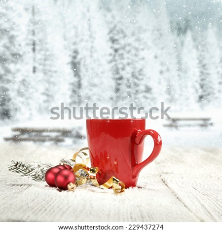 winter decoration of ball red mug and winter table  - stock photo