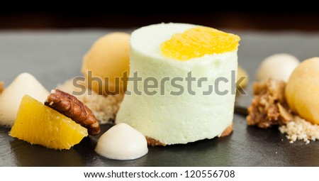 Winter Desert with Apple Mousse and Orange Sorbet - stock photo