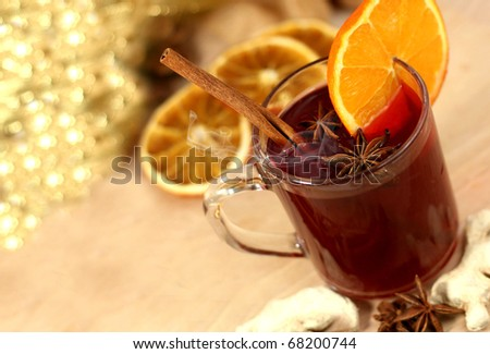Winter drink with oranges and cloves - stock photo
