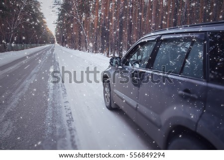 Winter drive, car on winter forest landscape