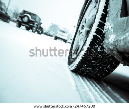 Winter driving conditions. Snow storm, snow tires,driving hazards and weather concept. - stock photo