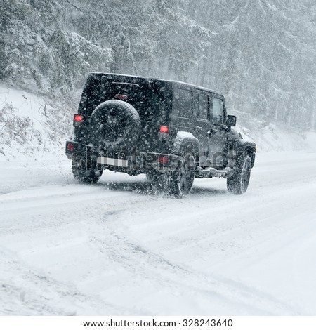 Winter Driving - risk of snow and ice - drifting - stock photo