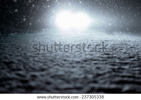 Winter Driving - Snowy Foggy Road at Night - stock photo