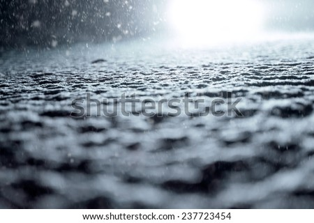 Winter Driving - Winter Road - Abstract winter background - Snow covered road at night. - stock photo