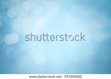 Winter elegant bokeh background. Seasonal cooling light decorative abstract design element. - stock photo