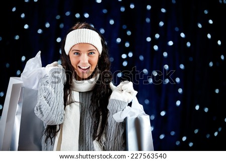 Winter: Excited Woman Holding Christmas Gift Purchases - stock photo