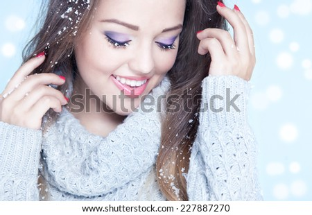 Winter face close up of young attractive woman covered with snow flakes. Christmas concept. - stock photo