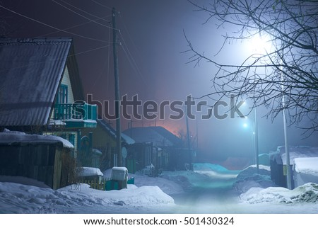 Winter fairy. Night shot of country street under snow in winter season.  Novosibirsk, Siberia, Russia