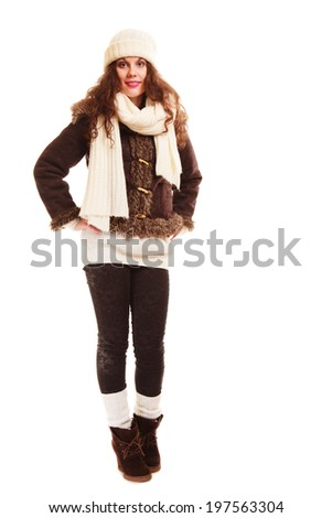 Winter fashion. Full length of curly girl. Young woman in warm clothing isolated. Studio shot. - stock photo