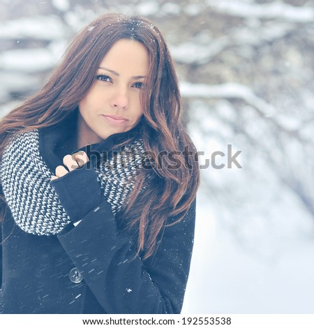 Winter fashion outdoor portrait of young attractive brunette - stock photo