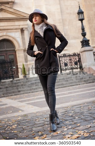 Winter fashion street portrait of a gorgeous young brunette woman. - stock photo
