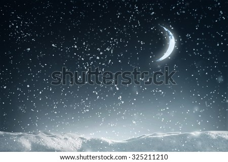 Winter flying snow in night over dark sky with moon and stars - stock photo