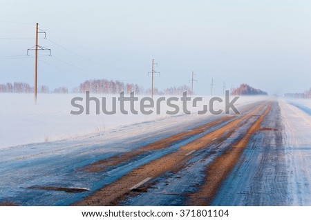 Winter fog and ice slick illustrating bad road conditions - stock photo